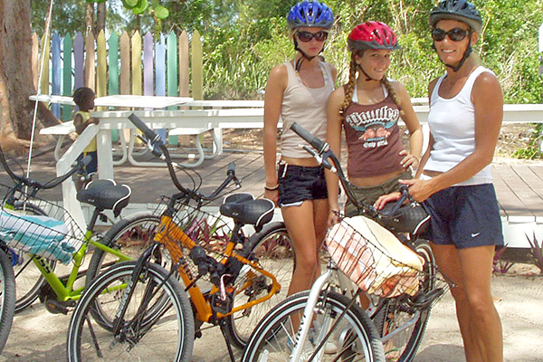 Mom & Daughters Getting Bikes for Tour in Bahamas